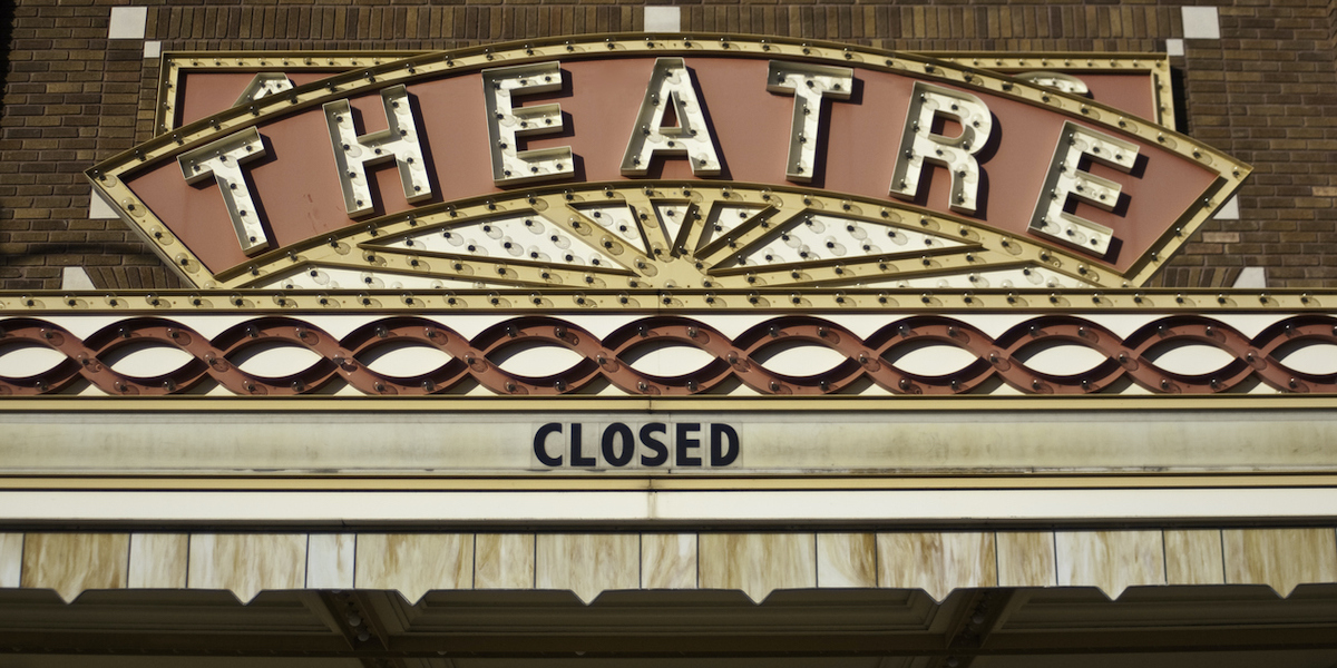 Closed sign on movie theater