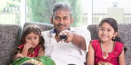 indian family watching TV.jpg