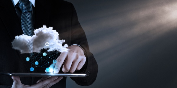 Man holding tablet with cloud image hovering above to illustrate DRM Solutions and Content Protection in Cloud TV