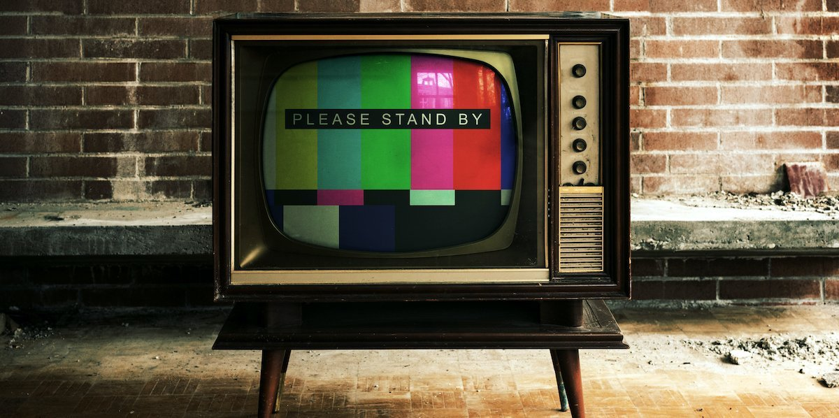 Old television set displaying test card